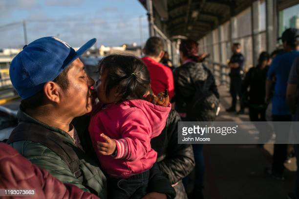 Mexican asylum seeker L waits with his family on the international bridge from Mexico to the United States on December 09 2019 next to the border...