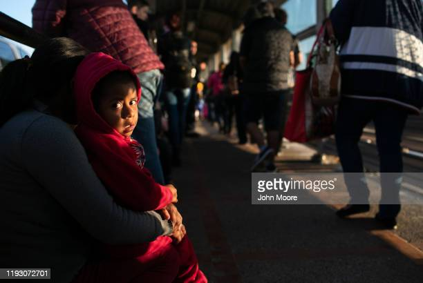 Mexican asylum seeker waits with his mother on the international bridge from Mexico to the United States on December 09 2019 next to the border town...
