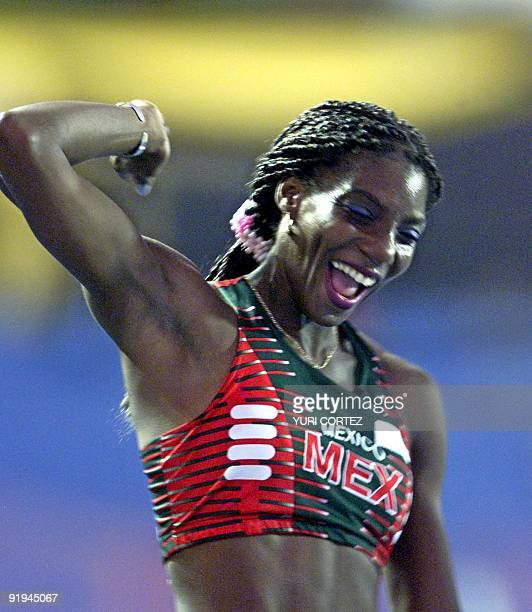 Mexican athlete celebrates after winning the gold medal in San Salvador El Salvador 05 December 2002 La mexicana Liliana Allen Doll festeja luego de...
