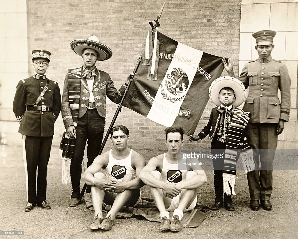 Mexican athletes prior to boarding the SS Majestic en route to the Olympic Games in Paris on 6th July 1924. Left to right, Major Manuel Solis, champion shot; Alfredo Guellar, team captain; Jesus Aguirre, shot put; Francisco Contreras, long jump; Ruben Solis, team mascot; and Pedro Curiel, middle distance runner.