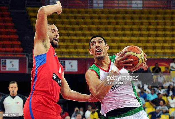 Mexican basketball player Gustavo Ayon vies for the ball with Puerto Rican Ricardo Sanchez during their FIBA Championship final game held in Caracas...