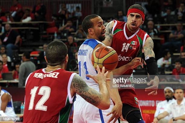 Mexican basketball player Lorenzo Mata passes the ball to Hector Hernandez under the mark of Puerto Rican Ricardo Sanchez during their Spain 2014...