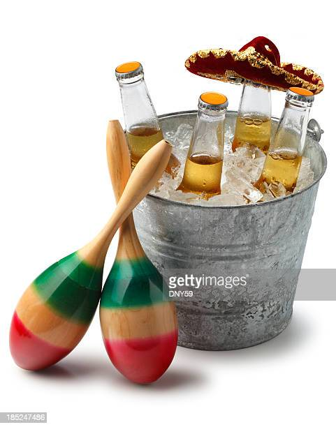 mexican beer on ice - maraca stock photos and pictures