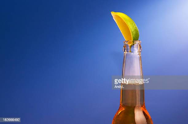 mexican beer with lime on blue - drunk mexican stock pictures, royalty-free photos & images