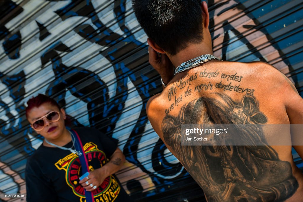 A Mexican believer shows his Santa Muerte tattoo during a