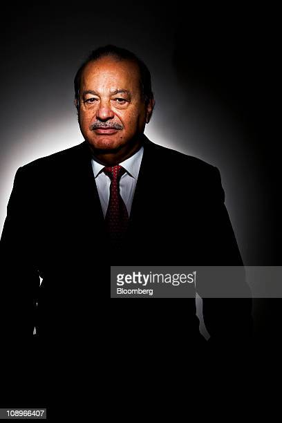 Mexican billionaire Carlos Slim stands for a photograph in New York US on Wednesday Feb 9 2011 Slim named the world's richest man by Forbes Magazine...