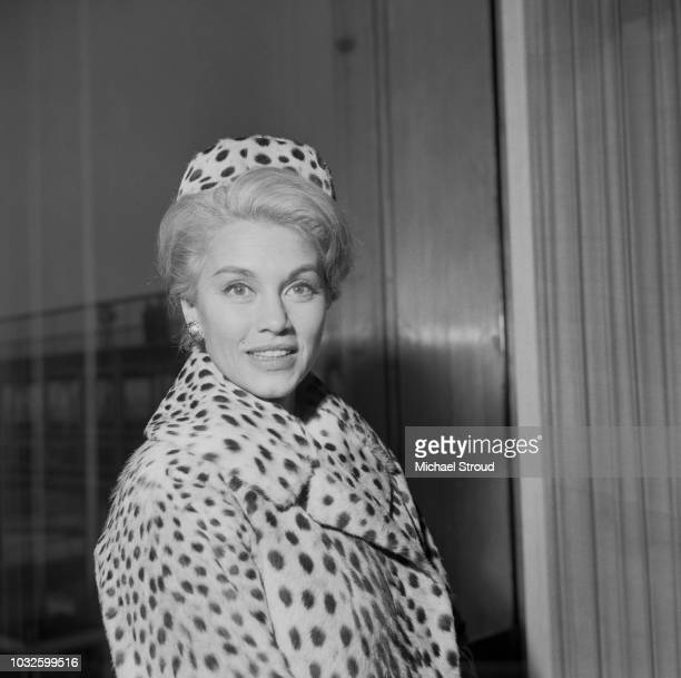 Mexican born actress Linda Christian posed wearing a spotted fur coat and matching hat at London airport as she awaits a flight to Rome Italy on 11th...