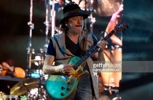 Mexican born guitar player Carlos Santana performs during the second day of the 'Vive Latino' music festival in Mexico City on March 17 2019