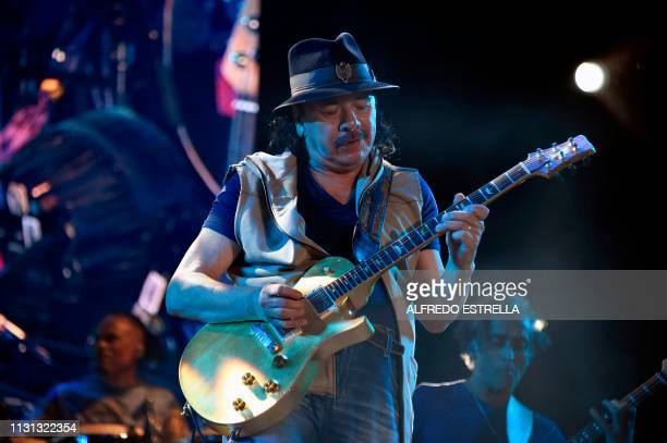 Mexican born guitar player Carlos Santana performs during the second day of the Vive Latino music festival in Mexico City on March 17 2019