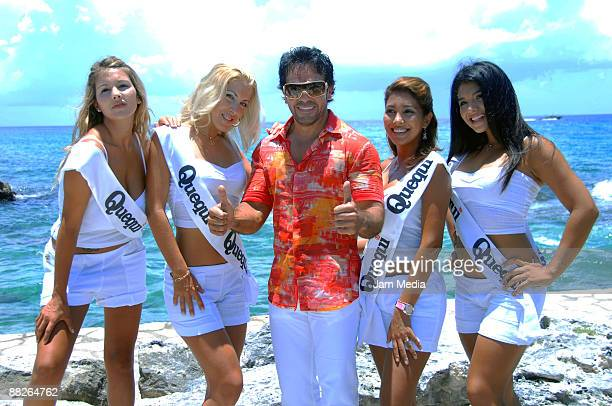 Mexican boxing promotor Jose Gomez poses alongside ring girls during the Mayan Challenge at Xcaret's weighin ceremony on June 5 2009 in Xcaret Mexico
