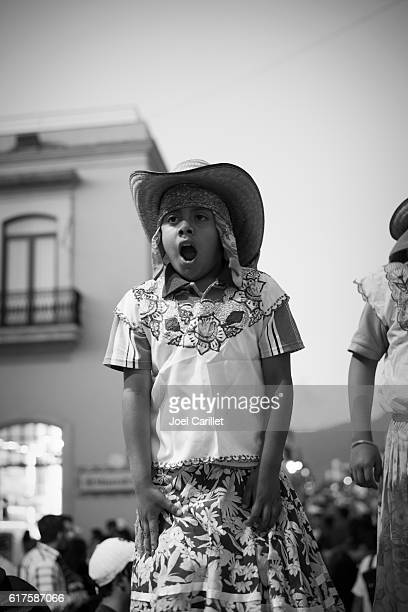 mexican boy on stilts in oaxaca, mexico - mexico black and white stock pictures, royalty-free photos & images