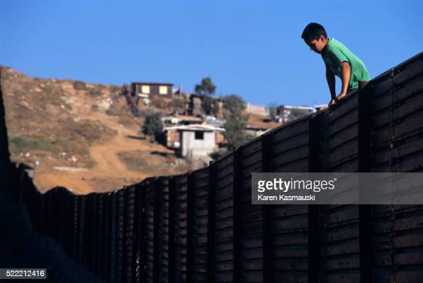 Mexican Boy Scales Border Fence