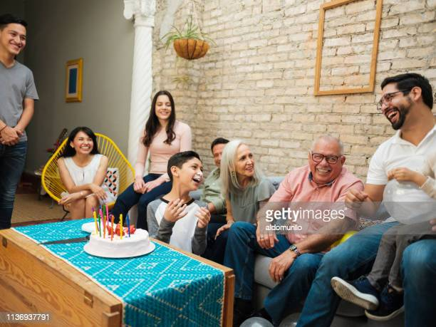 mexican boy with cake on face - large family stock pictures, royalty-free photos & images
