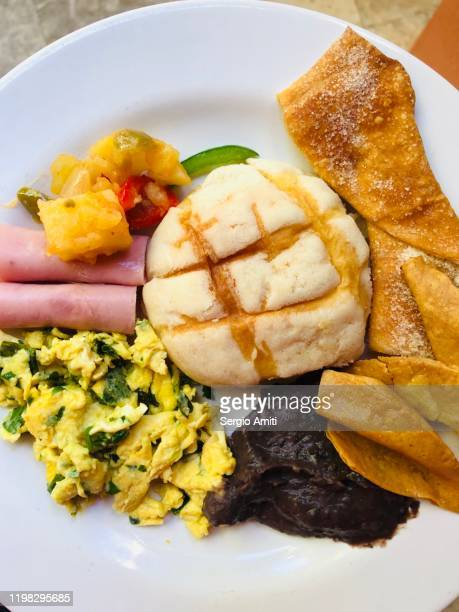 mexican buffet breakfast plate - mole sauce stock pictures, royalty-free photos & images