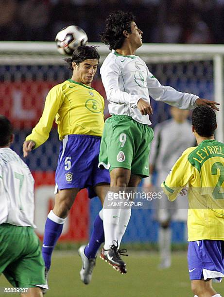 Mexican Carlos Vela and Roberto from Brazil jump to head the ball during their FIFA U17 final match in Lima 02 October 2005 AFP PHOTO/JAIME RAZURI
