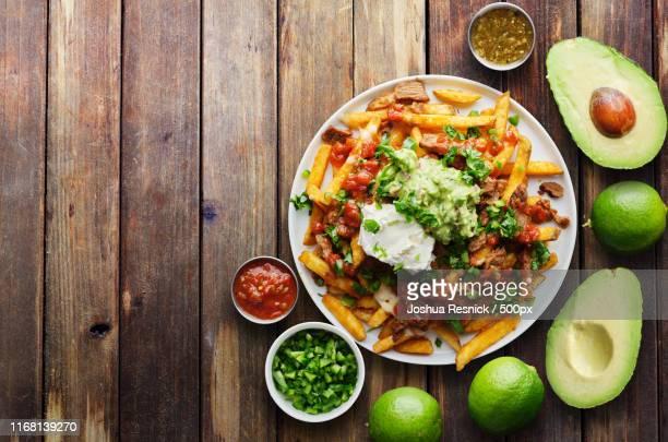 mexican carne asada fries in copy space composition shot from birds eye view - carne assada imagens e fotografias de stock