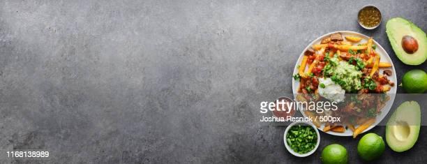 mexican carne asada fries with panoramic copy space composition - carne assada imagens e fotografias de stock