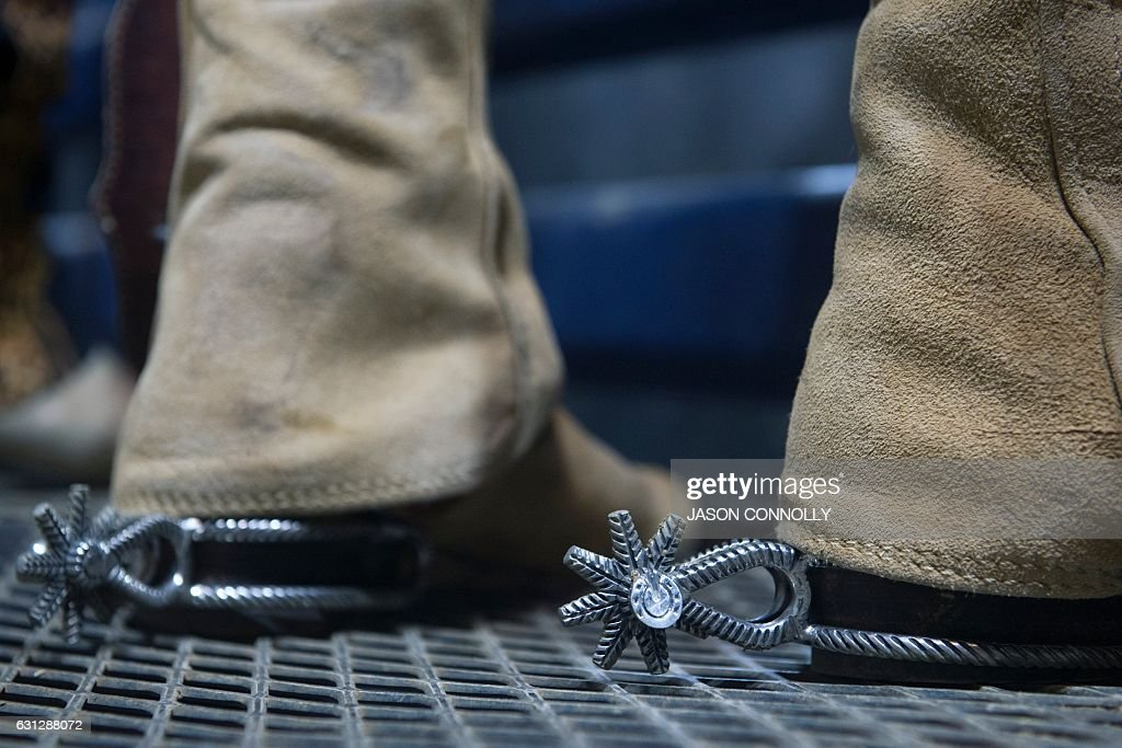 A Mexican charro wearing a pair of ornate spurs, waits to compete in the final round of bareback riding during the 23rd Annual Mexican Rodeo Extravaganza at the National Western Stock Show in Denver, Colorado on January 8, 2017. Established in 1911, the National Western Stock Show is the premier livestock, rodeo, and horse show in the United States. / AFP / Jason Connolly