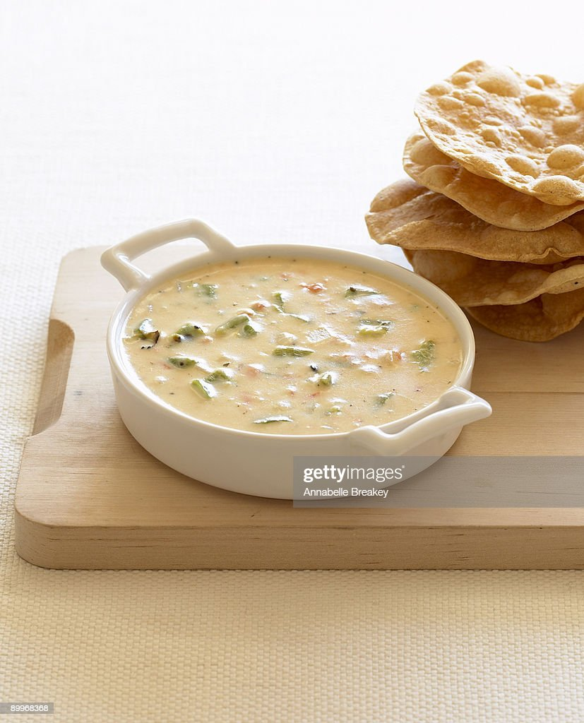 Mexican cheese and chilies dip and fried tortillas : Stock Photo