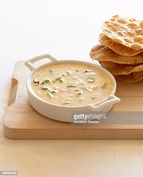 mexican cheese and chilies dip and fried tortillas - dipping sauce stock photos and pictures