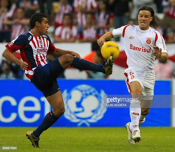 Mexican Chivas' Patricio Araujo vies for the ball with Brazilian Internacional's Marcos Alberto Marcao during their Copa Sudamericana 2008 semifinal...