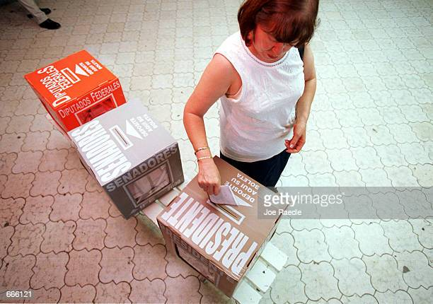 Mexican citizen casts her vote in the Mexican presidential election at the casilla especial a special voting place set up July 2 2000 in Ciudad...