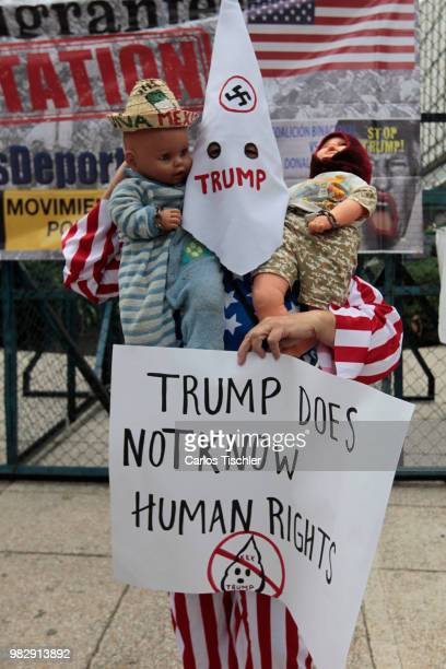 Mexican citizen holds a placard that reads 'Trump does not know human rights' protest against US president Donald Trump because of the acts of...