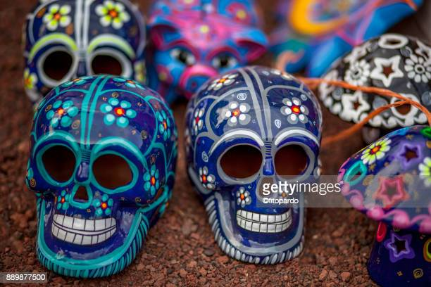 mexican clay skulls - sugar skull stock photos and pictures