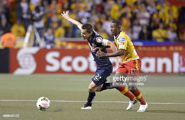 Mexican Club America Paul Aguilar and Edeer Nelson of Club Sport Herediano vie for the ball during the quarterfinals of the Concacaf Champions League...