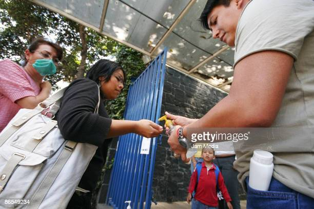 Mexican college student washes the hands before her first day in class since the alert of the A Flu stopped the activities on schools on May 07 2009...