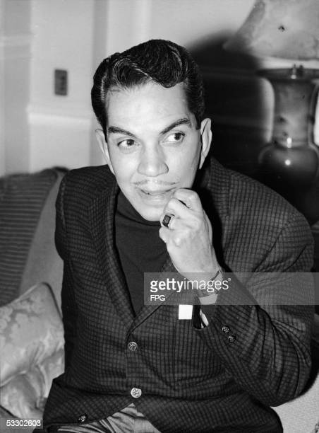 Mexican comedian Cantinflas looks thoughtful as he sits in his London hotel room before meeting actors for casting in his new film 'Pepe' London...