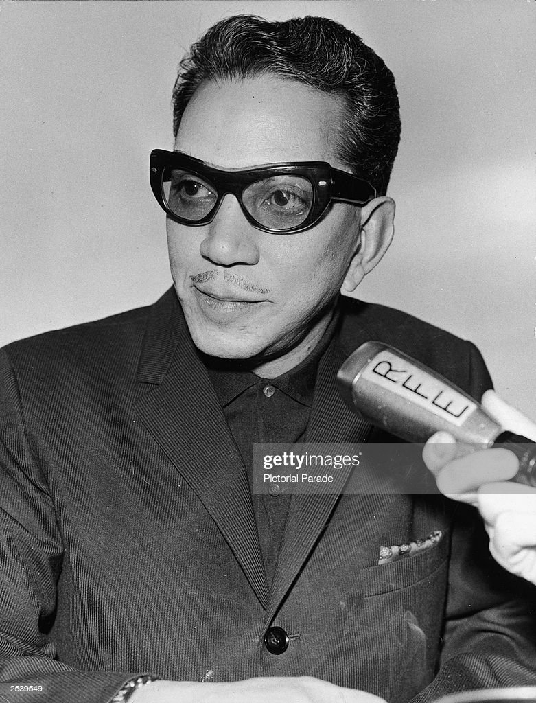 Mexican comic actor and humanitarian Cantinflas (Mario Moreno Reyes, 1911 - 1993) speaks into a microphone during an interview with Radio Free Europe, Munich, circa 1955.