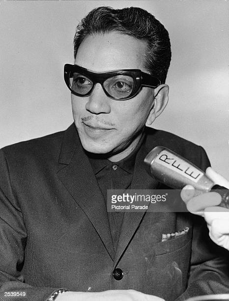 Mexican comic actor and humanitarian Cantinflas speaks into a microphone during an interview with Radio Free Europe Munich circa 1955