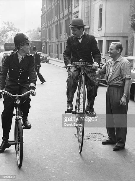 Mexican comicactor Cantinflas practises on his pennyfarthing bicycle for a scene in 'Around the World in Eighty Days' 26th August 1955 He is stopped...