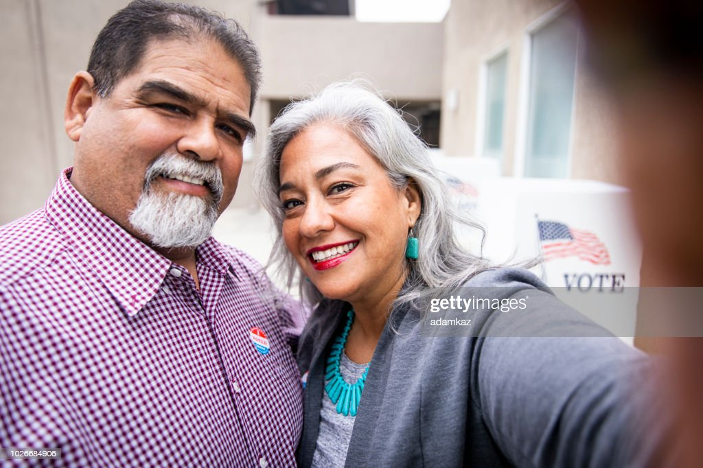 Mexican Couple Taking a Selfie at Voting Booth : Stock Photo