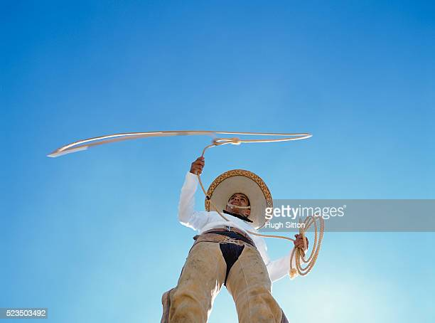 mexican cowboy holding lasso, mexico - hugh sitton stock pictures, royalty-free photos & images