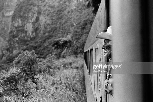 Mexican cowboy looks at the jungle while standing between the cars of the legendary Chihuahua-Pacífico train in the nothern Mexico, 22 September 1998.