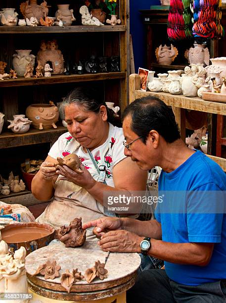 Mexican Craftsmen Making Clay Figurines