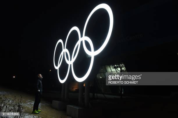 TOPSHOT Mexican cross country skier German Madrazo poses next to Olympic rings at the Alpensia Olympic Park on the eve of the opening of the...