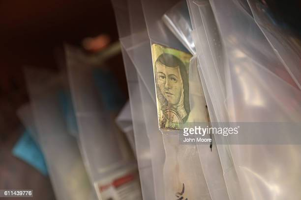Mexican currency hangs with personal effects of suspected undocumented immigrants the Office of the Pima County Medical Examiner on September 29 2016...