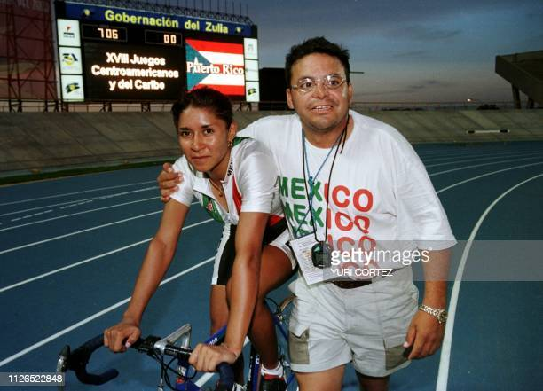 Mexican cyclist Nanci Contreras walks with her coach after winning the 500 meter race in the Pachencho Romero Stadium in Maracaibo Venezuela during...
