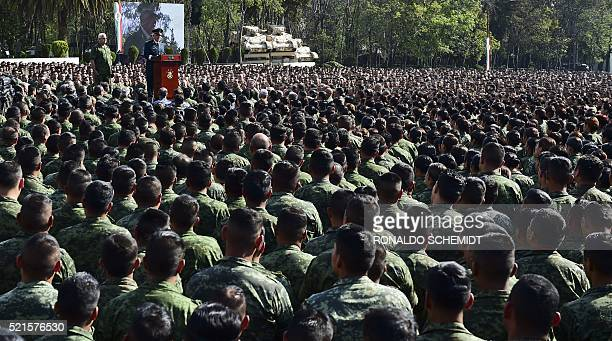Mexican Defense Secretary Salvador Cienfuegos reads out a public apology before 26000 soldiers assembled at a military base in Mexico City on April...