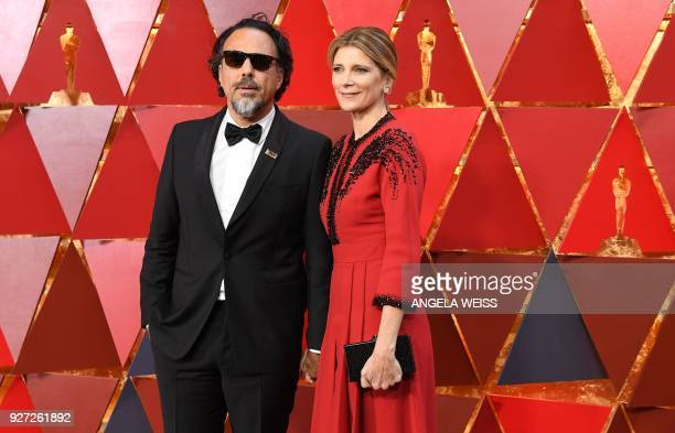 Mexican director Alejandro Gonzalez Inarritu and his wife Maria Eladia Hagerman arrive for the 90th Annual Academy Awards on March 4 in Hollywood...