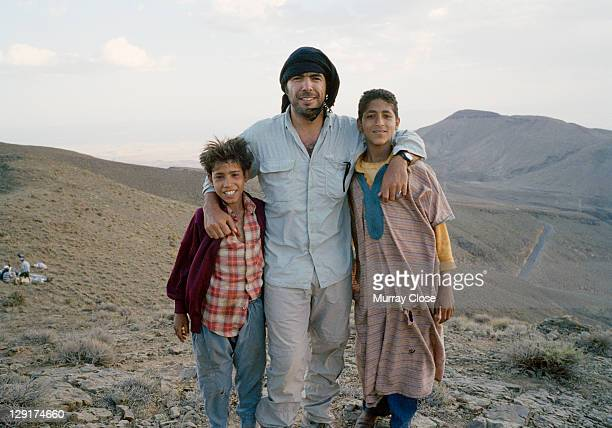 Mexican director Alejandro Gonzalez Inarritu with local actors Boubker Ait El Caid and Said Tarchani during the filming of 'Babel' on location in...