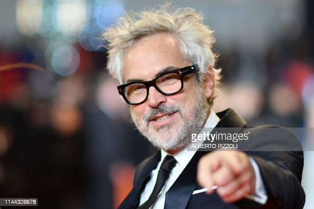 Mexican director Alfonso Cuaron arrives for the screening of a remastered version of the film The Shining at the 72nd edition of the Cannes Film...