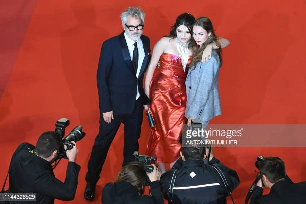 Mexican director Alfonso Cuaron his daughter Tess Bu Cuaron and US actress Johnny Sequoyah pose as they arrive for the screening of a remastered...