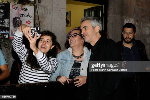 Mexican director Alfonso Cuaron poses with fans during the red carpet of 'The Shape of Water' as part of the XV Morelia International Film Festival...