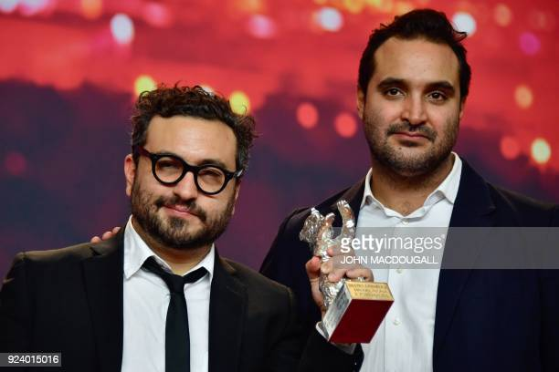 Mexican director Alonso Ruizpalacios and Mexican scriptwriter Manuel Alcala pose after receiving the Silver Bear for Best Script award for 'Museum'...