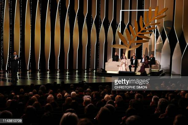 Mexican director and President of the Jury of the Cannes Film Festival Alejandro Gonzalez Inarritu delivers a speech on stage next to jury members...