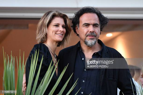 Mexican director and President of the Jury of the Cannes Film Festival Alejandro Gonzalez Inarritu and his wife Maria Eladia Hagerman pose on May 13...